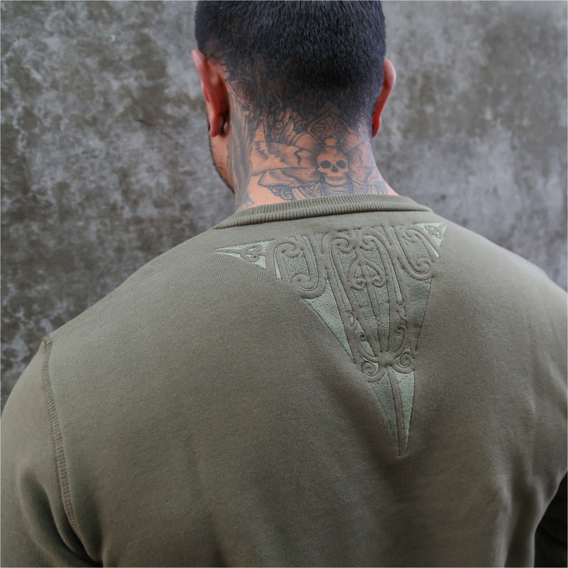 Mens army green jersey with embroidered maori design from streetwear brand Cravass