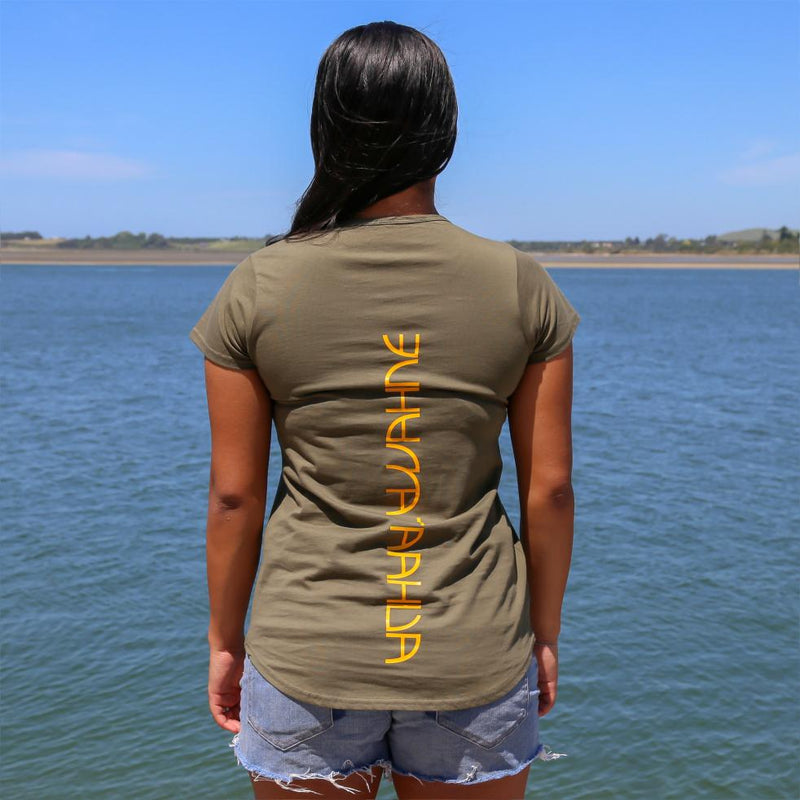 Women's green tshirt with yellow maori design stripe from cravass.. Back view with the words Ataahua Wahine.