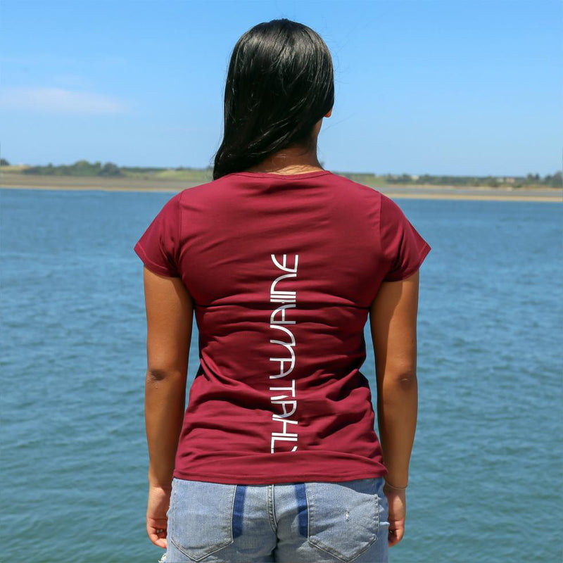 Women's burgundy tshirt with white maori design stripe from cravass.. Back view with the words Ataahua Wahine.