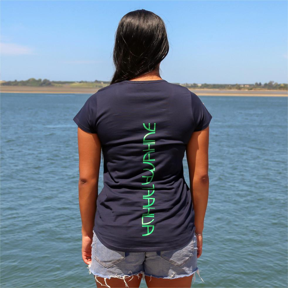 Women's navy tshirt with green maori design stripe. Back view with the words Ataahua Wahine.