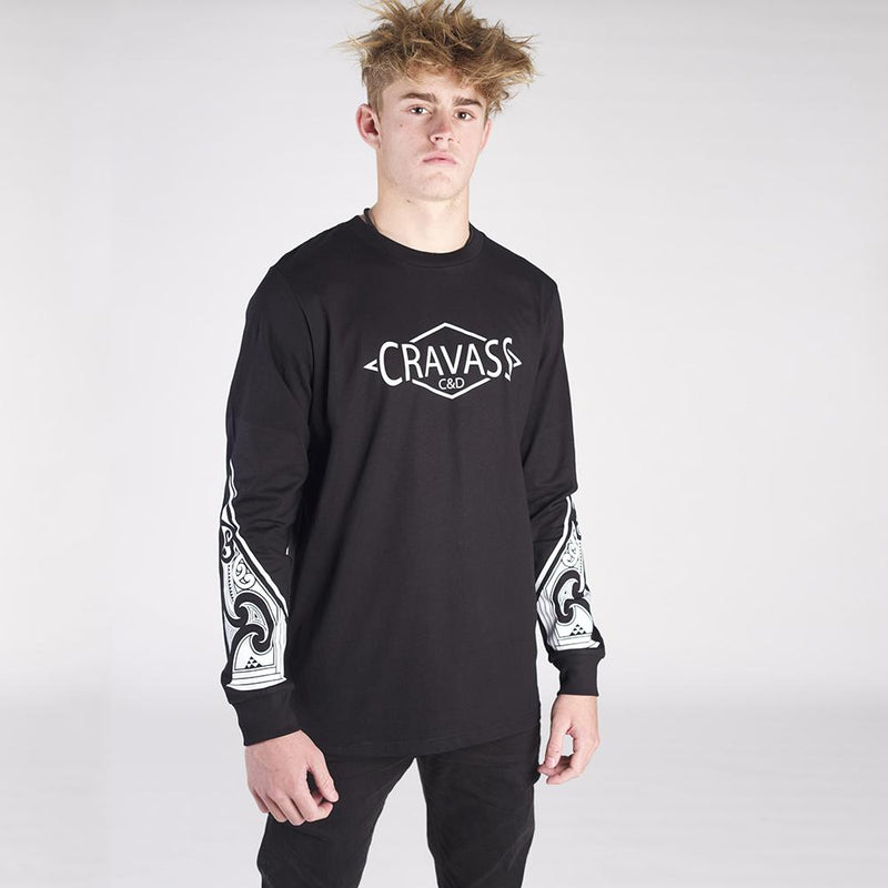 Mens black long sleeve tshirt with white NZ maori ta moko forearm design.