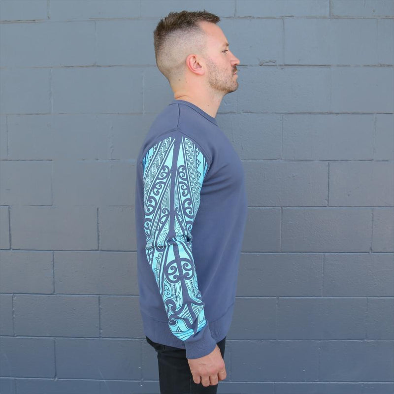 Blue Mens crew jersey with maori ta moko sleeve - side