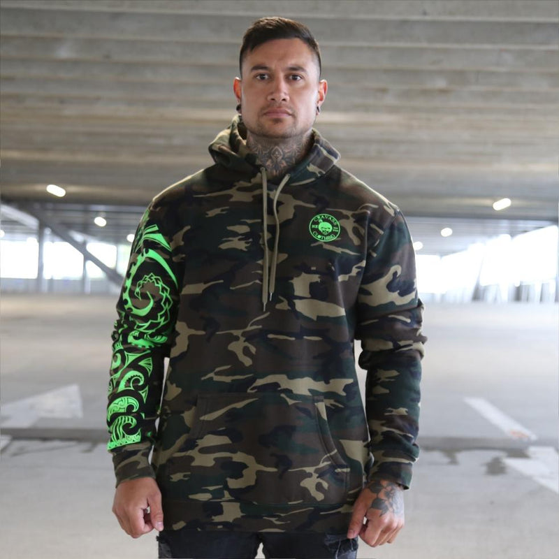 Camouflage jersey with fluro green maori ta moko sleeve. Front view
