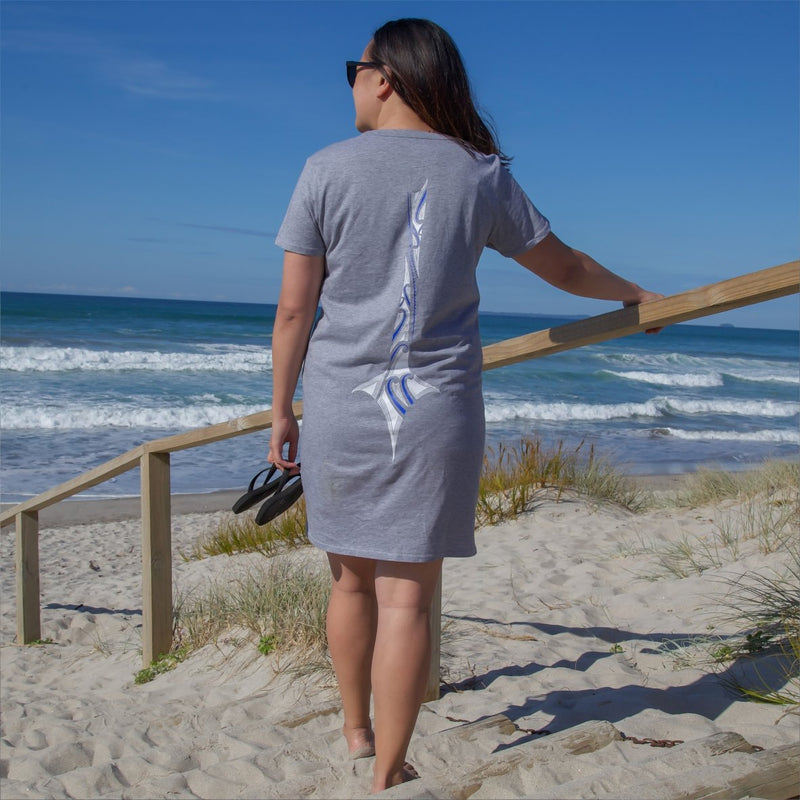 Model at the papamoa beach in tauranga wearing grey cravass dress.