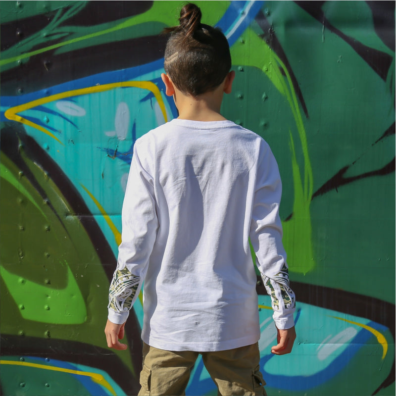 Kids white long sleeve tshirt with green camo maori design on the forearm form cravass clothing.
