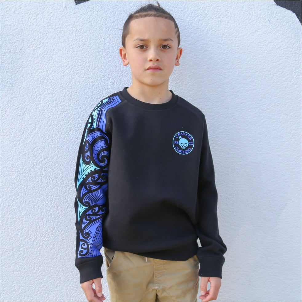 Childrens black jersey with blue maori design on the sleeve. Front