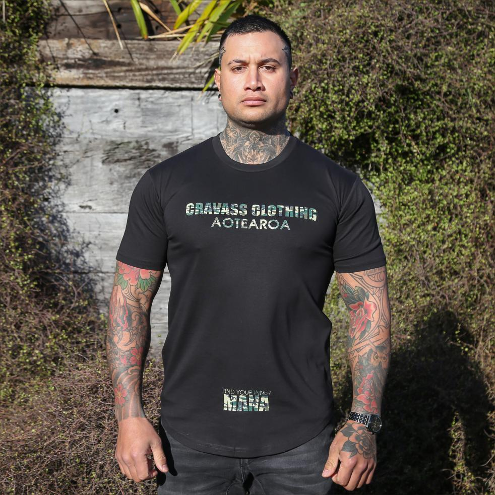 Mens black tshirt with Camo coloured logo from Cravass Clothing. Find your inner Mana