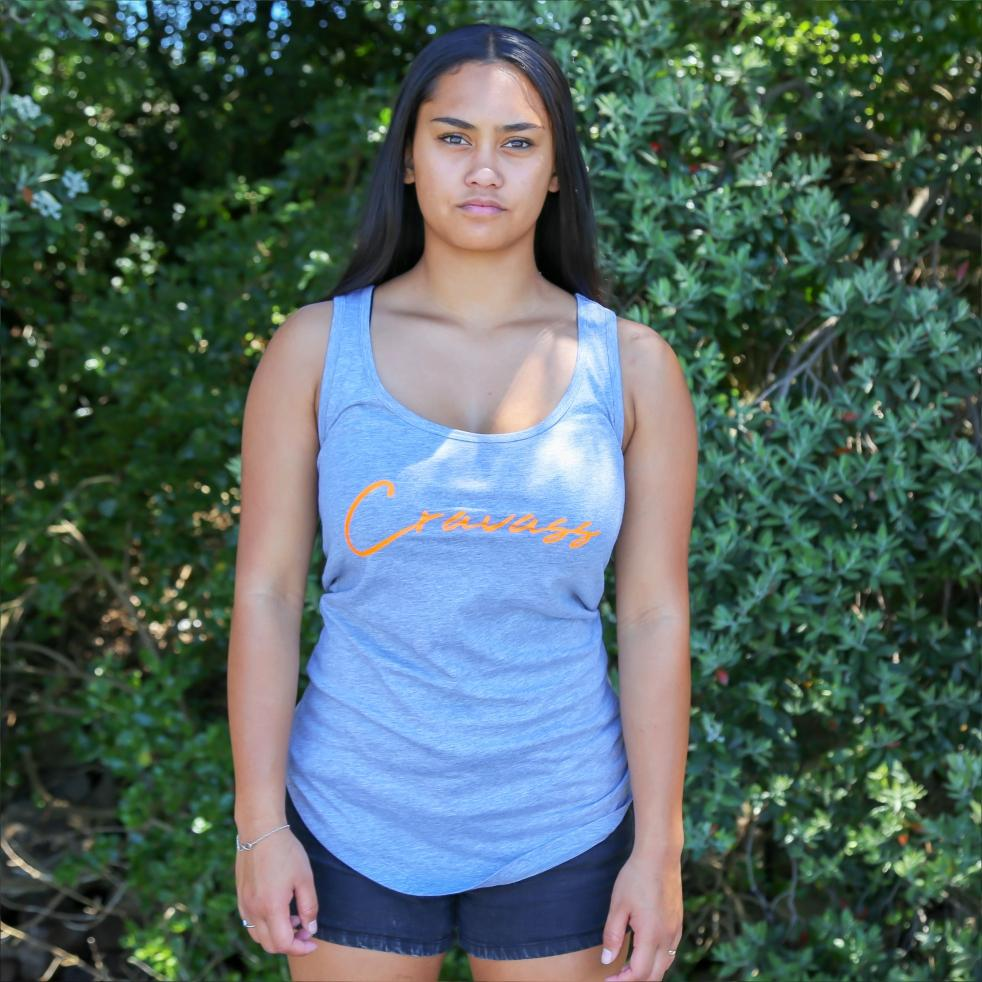 Womens grey singlet with a fluro orange and black maori design. Maori clothing with style. front view