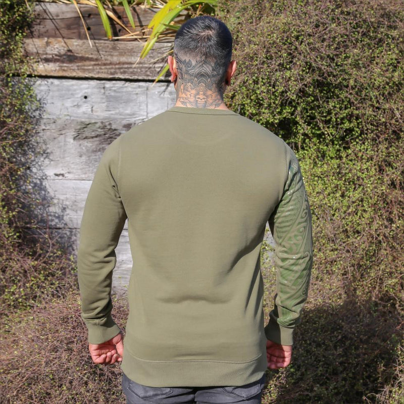Unisex army coloured crew jersey with Khaki green ta moko designed sleeve. Back view. Tattooed head