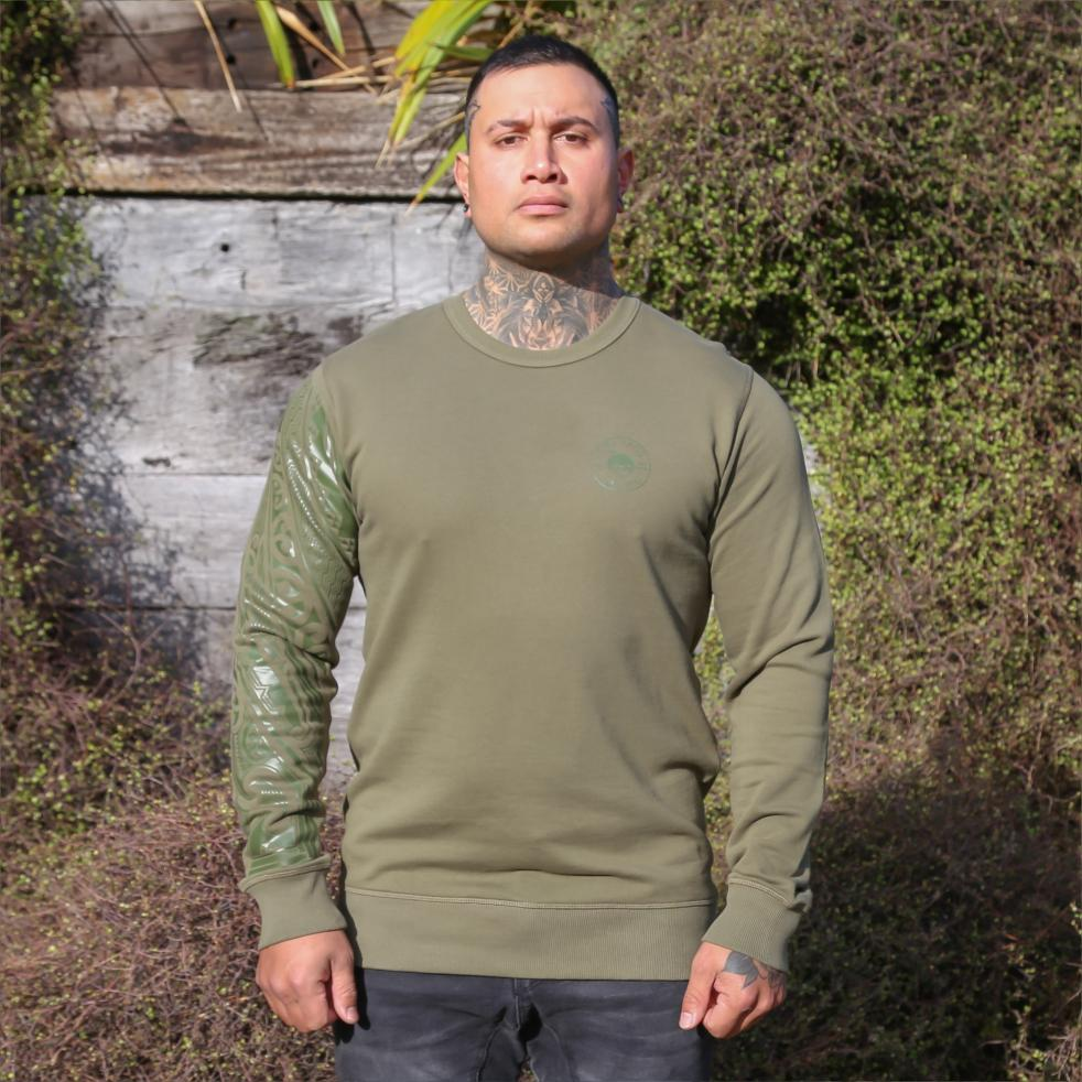Unisex army coloured crew jersey with Khaki green ta moko designed sleeve. Front view.