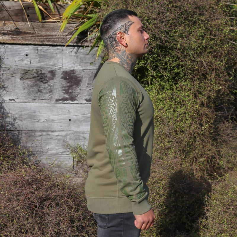 Unisex army coloured crew jersey with Khaki green ta moko designed sleeve. Side view.