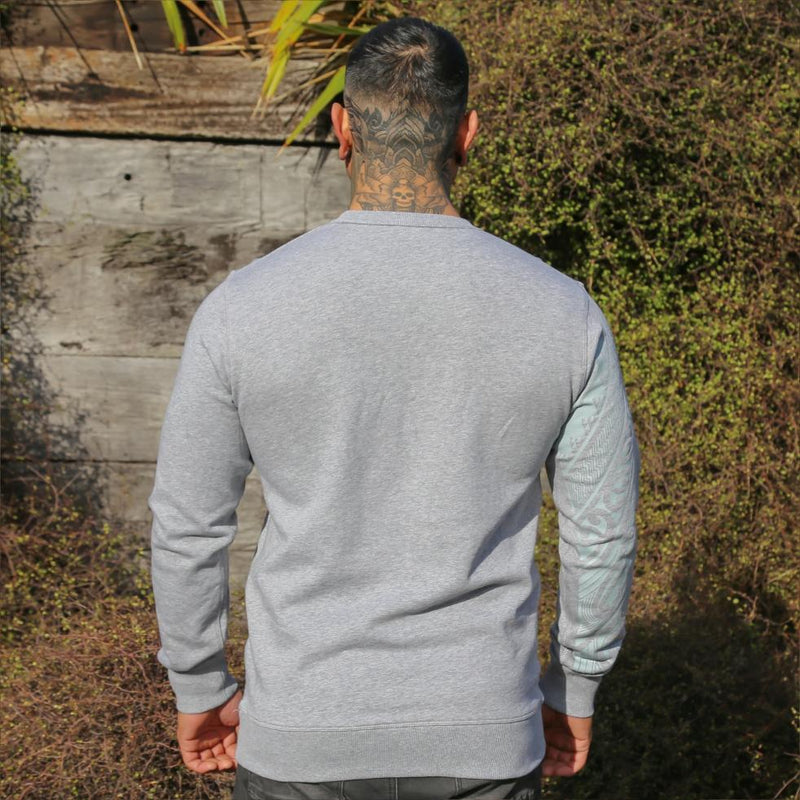 Grey unisex jersey with grey Ta Moko Maori Sleeve design. Back view.