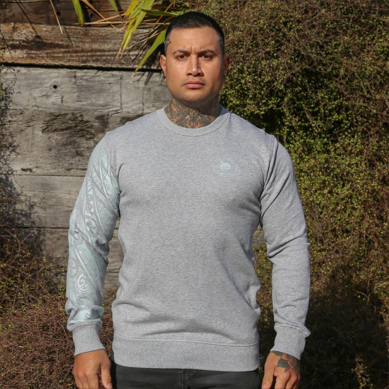 Grey unisex jersey with grey Ta Moko Maori Sleeve design. Front view.