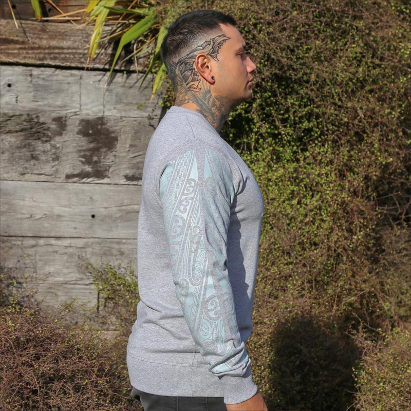 Grey unisex jersey with grey Ta Moko Maori Sleeve design. Side view.