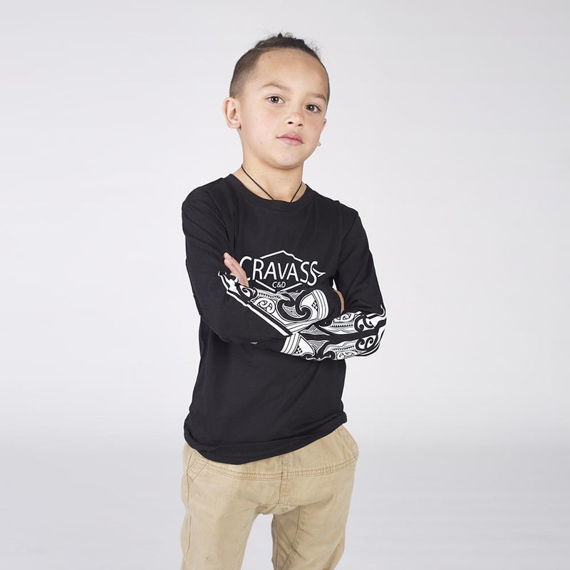 Kids black cravass long sleeve tshirt with white maori ta moko design on both forearms.