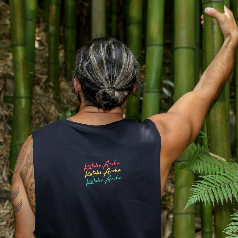 Model wearing black singlet with Rasta coloured Maori design from New Zealand clothing brand Cravass