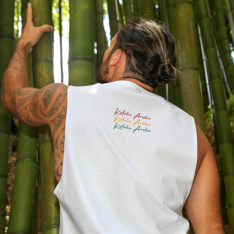 Model wearing White singlet with Rasta coloured Maori design from New Zealand clothing brand Cravass