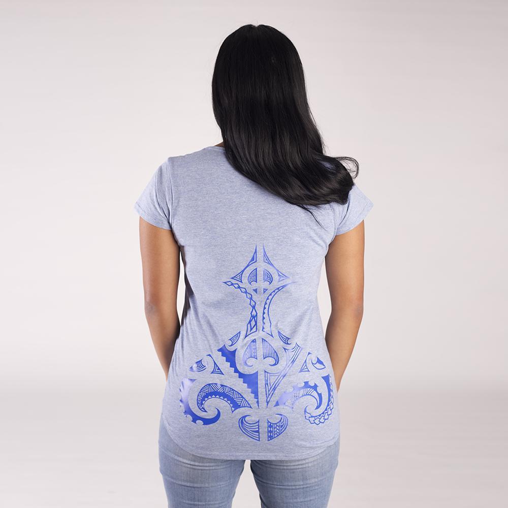 Back view of blue women's tshirt with original maori ta moko design on the lower back.