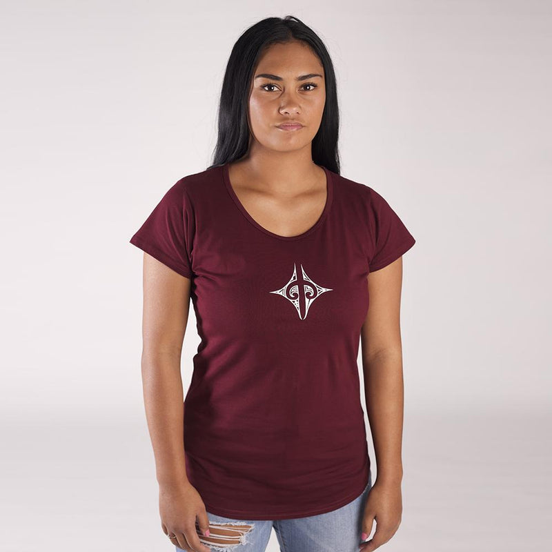 Model wearing beautiful burgundy womens tshirt with a small maori design on the front chest.