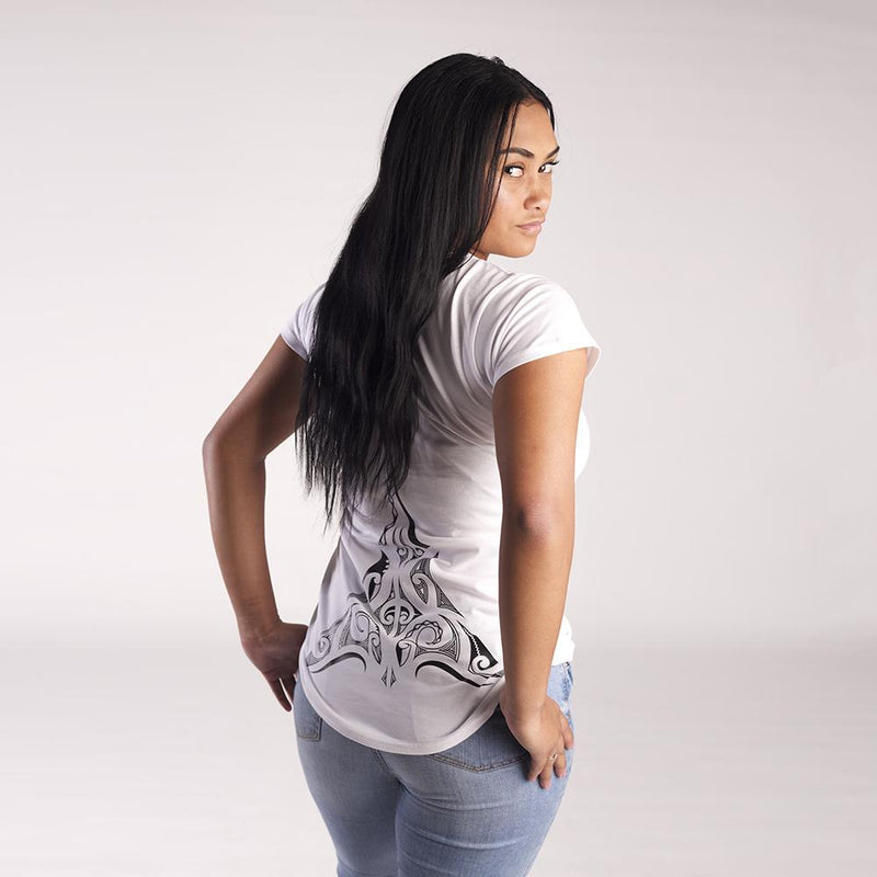 Back view of women's white tshirt with stunning lower back ta moko (tattoo) from the designers at Cravass