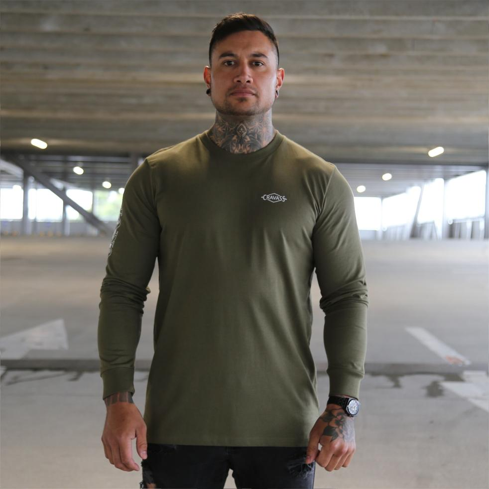 Mens green long sleeve tshirt with the meaning of the maori word mana on the back. Front view