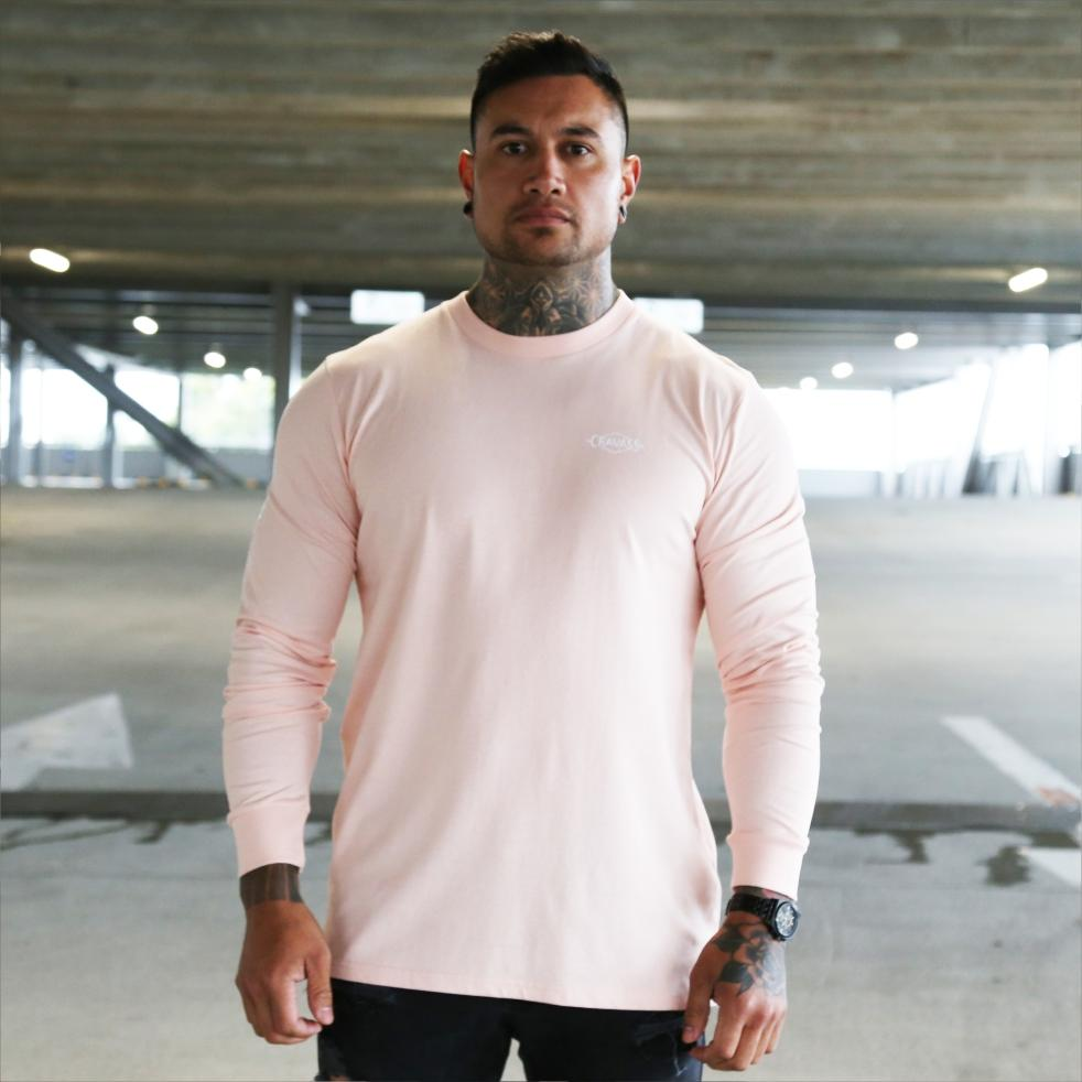 Mens pink long sleeve tshirt with white Maori design. Meaning of Mana. Front view.