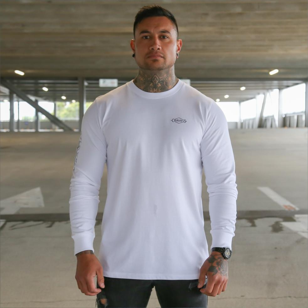 Mens white long sleeve tshirt with black Maori design. Meaning of Mana. Front view.