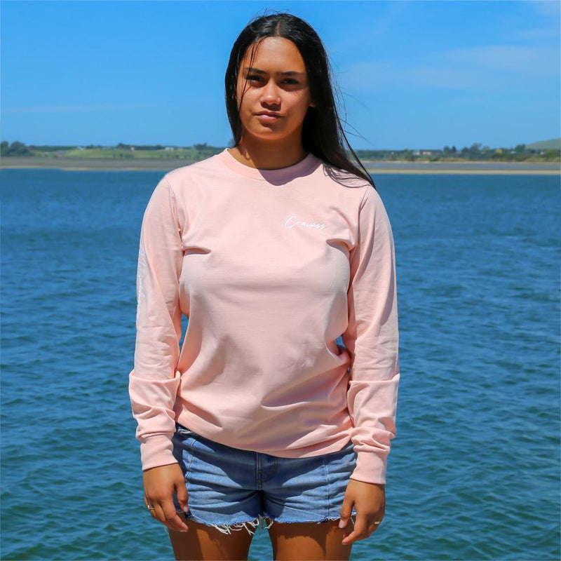 Women's pink long sleeve tshirt with the meaning of the maori word Mareikura. Front view