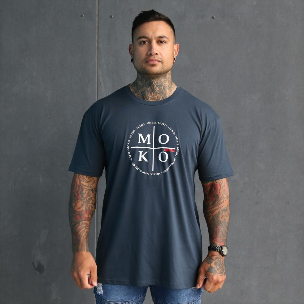 Mens blue tshirt with white maori wording design. Moko - maori artform or tattoo. Front view