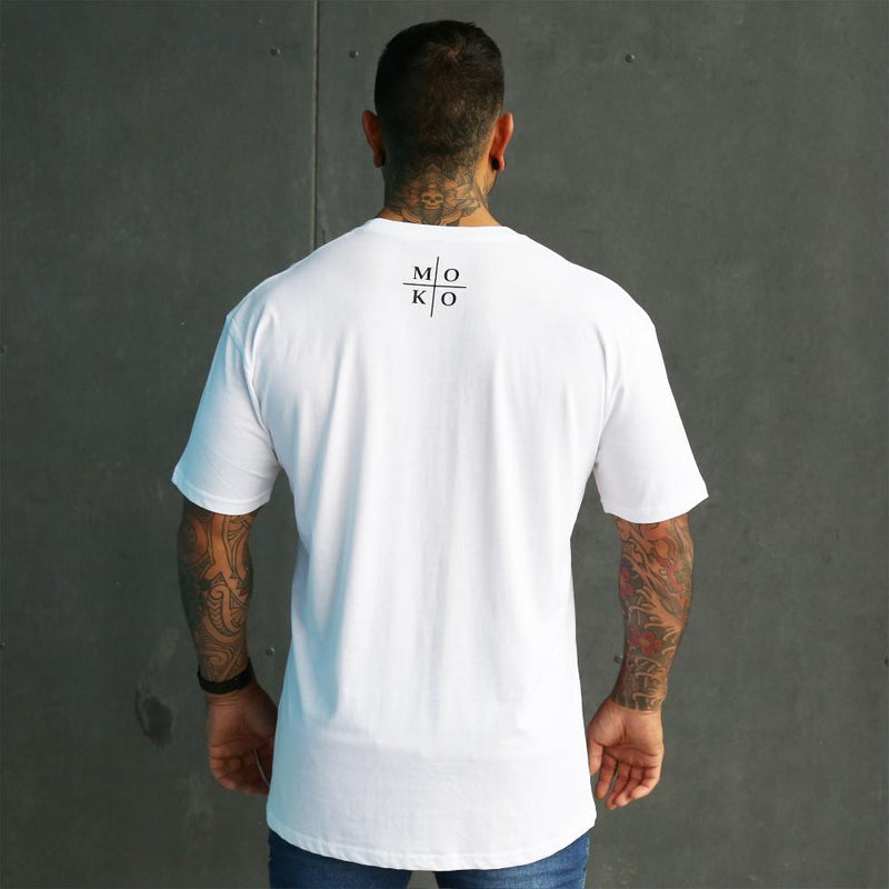 Mens white tshirt with round moko design on the front small logo on the neck. Moko (maori tattoo). Back view