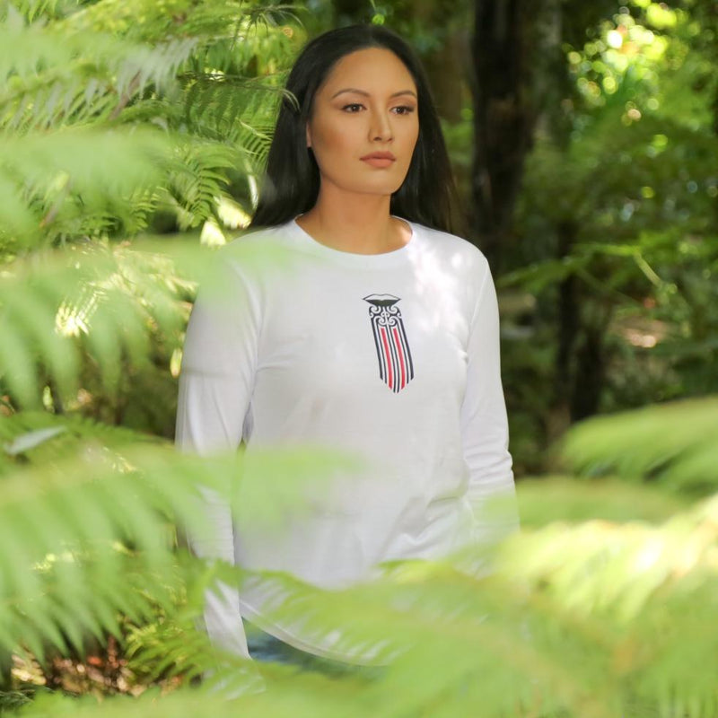Women's white long sleeve t shirt with black and red Maori Moko Kauae design from Cravass Clothing. Maori Clothing.