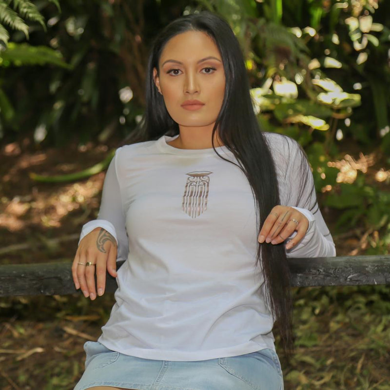 Women's white long sleeve t shirt with mocha Maori Moko Kauae design from Cravass Clothing. Maori Clothing.