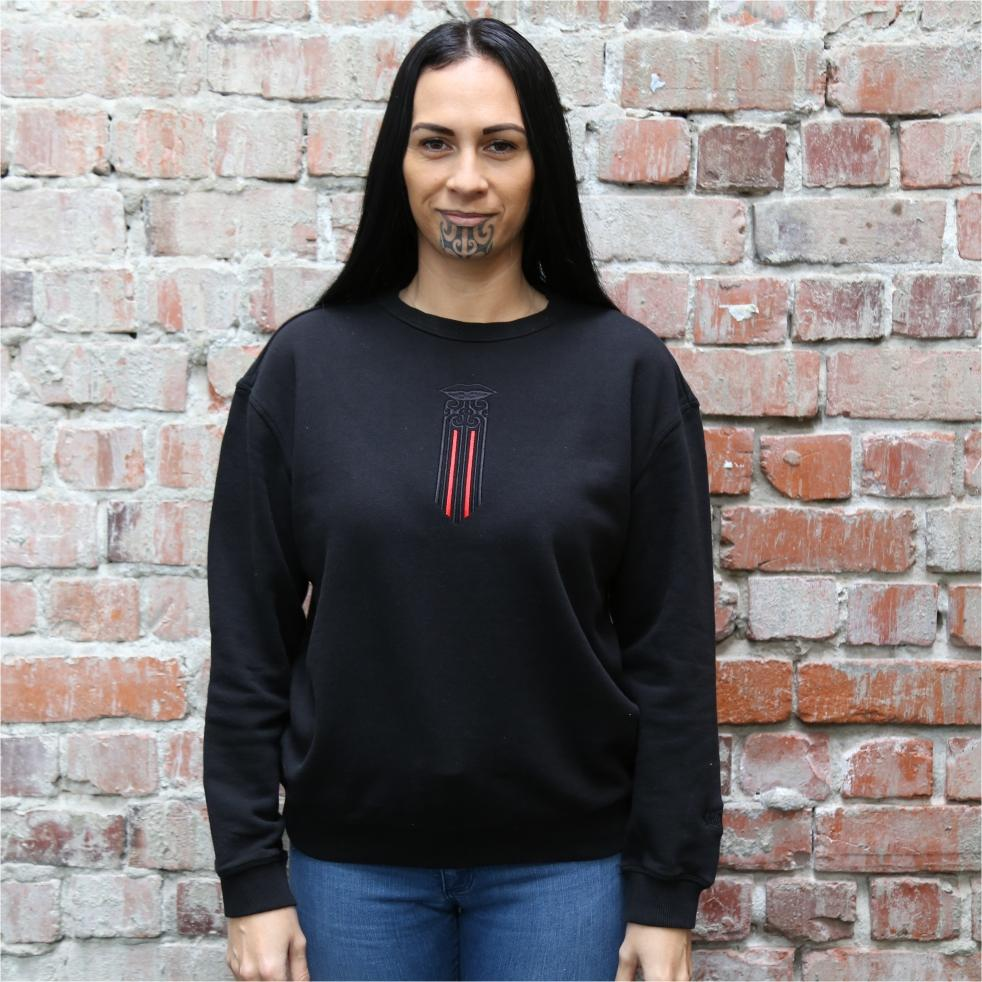 Women's black crew jersey with a black and red Maori moko kauae design.