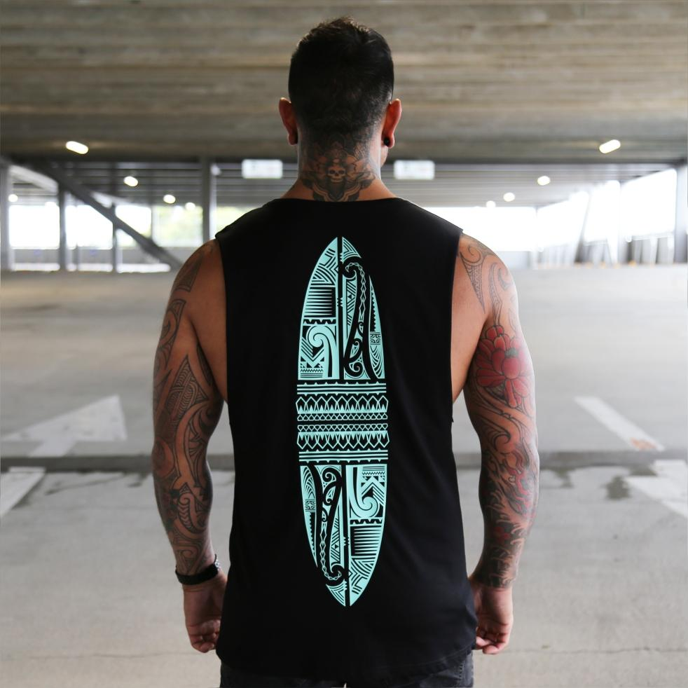Black unisex singlet with mint colour maori surfboard design. Maori clothing. Back view