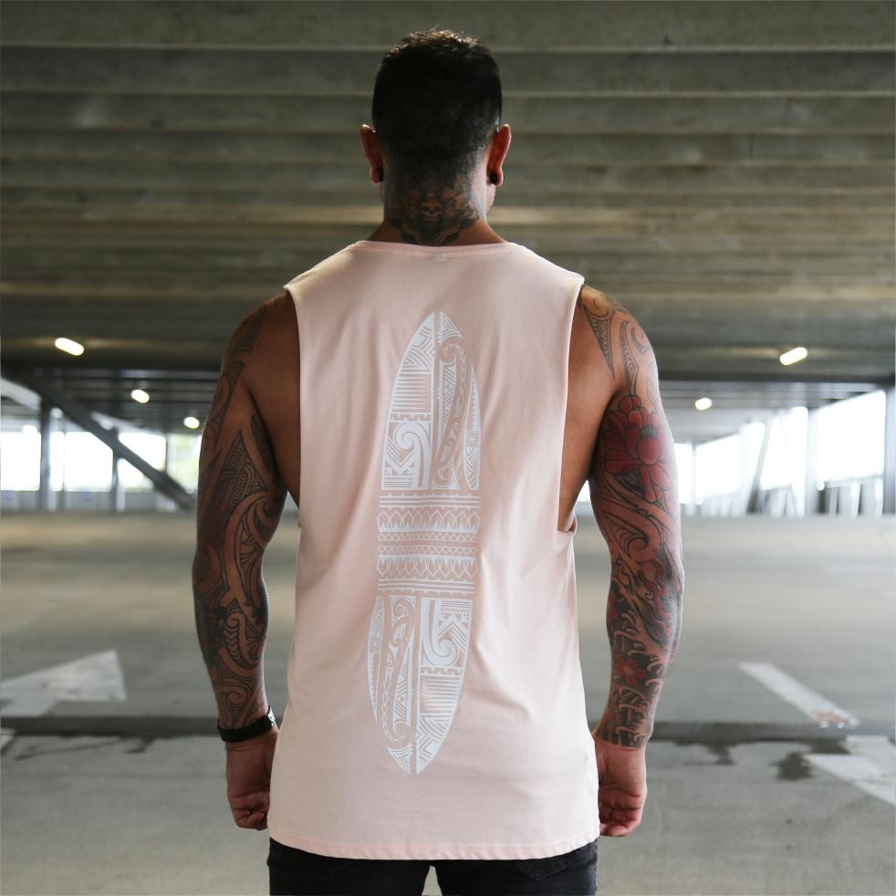 Pink unisex singlet with white maori designed surfboard. Maori clothing. Back view