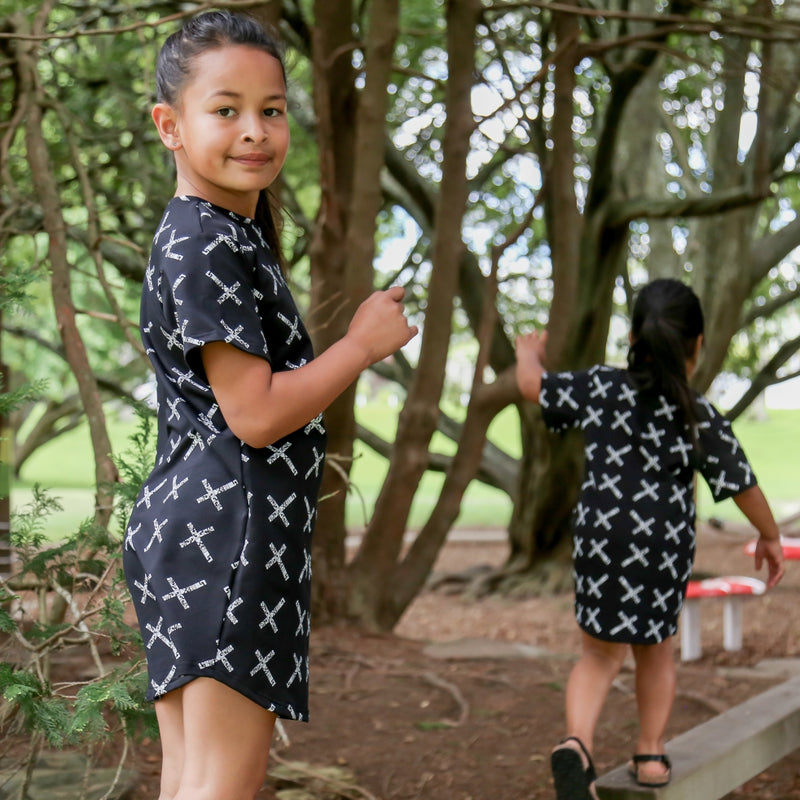 Black girls tshirt dress with white maori cross print. 2 cute maori girls