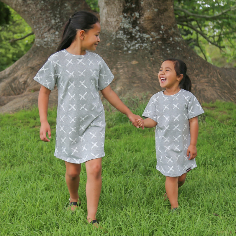 Grey girls tshirt dress with white maori cross print. 2 cute maori girls