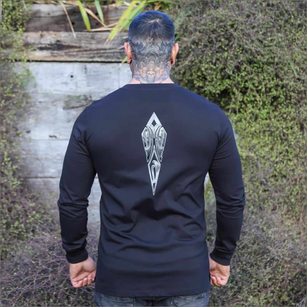 Male model wearing black long sleeve tshirt with Black and white contrast maori design from cravass clothing.