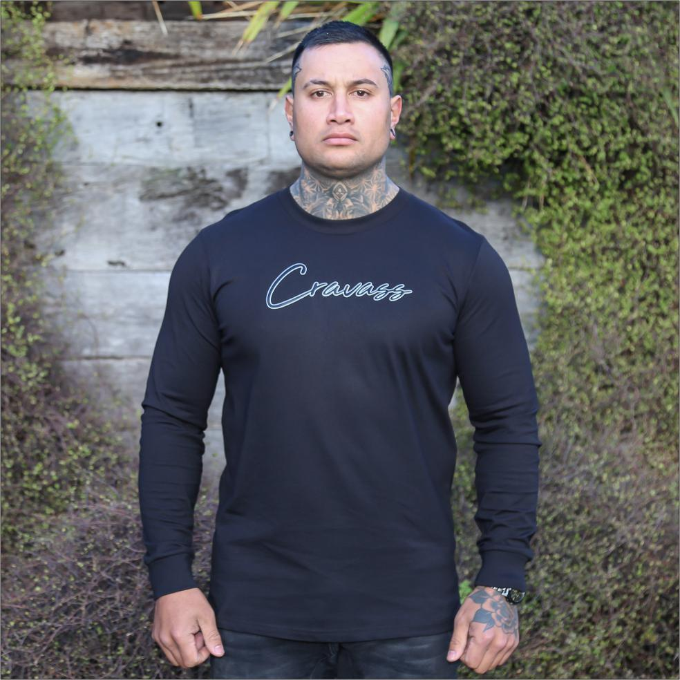 Male model wearing black long sleeve tshirt with Black and white contrast logo from cravass clothing.