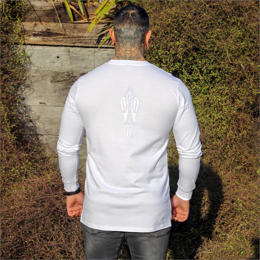 Male model wearing white long sleeve tshirt with white and blue contrast maori design from cravass.
