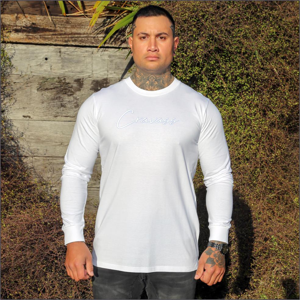 Male model wearing white long sleeve tshirt with white and blue contrast logo from cravass.