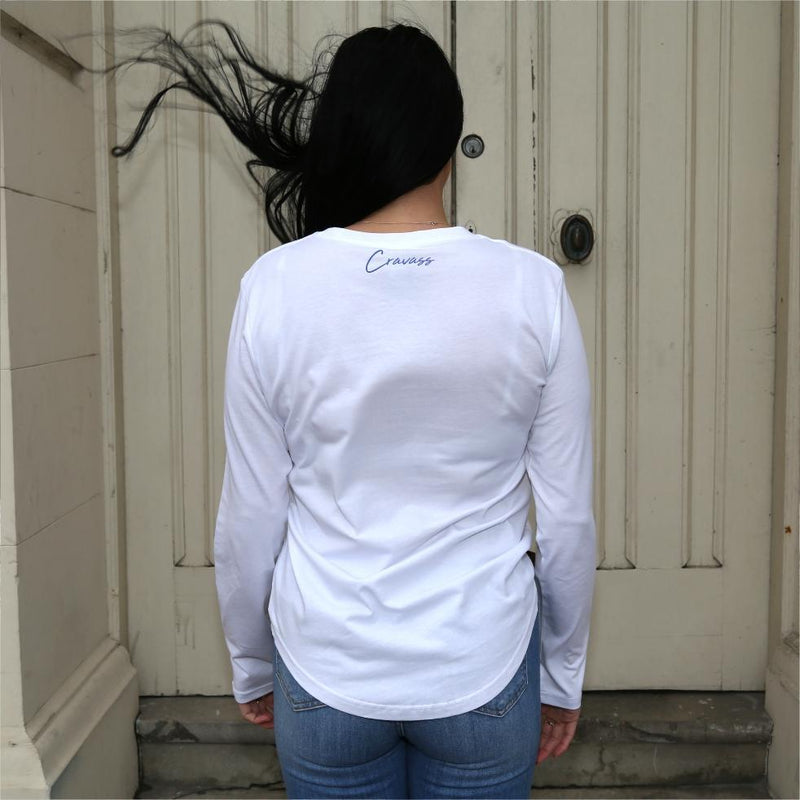 Women's white long sleeve tshirt with blue maori designs and Cravass logo. Back view