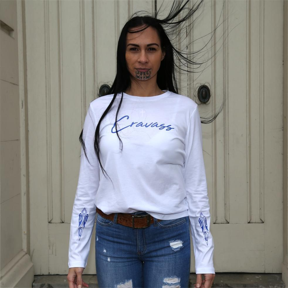 Women's white long sleeve tshirt with blue maori designs and Cravass logo.