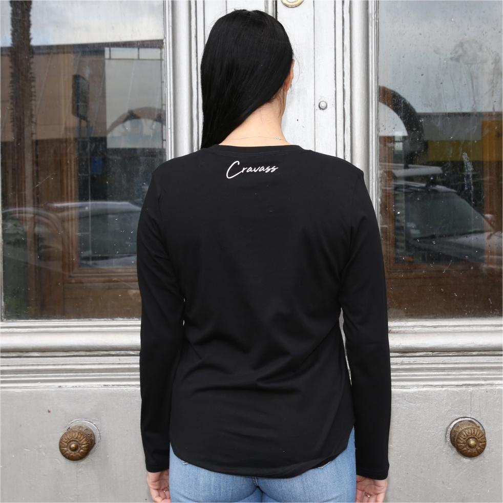Women's black long sleeve tshirt with Maori design and art on the forearm. Back view
