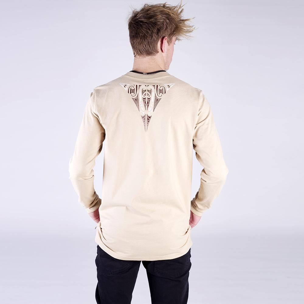 Back view of our Cravass Tapatoru long sleeve tshirt. Tan tshirt with brown and white maori design between the shoulders.