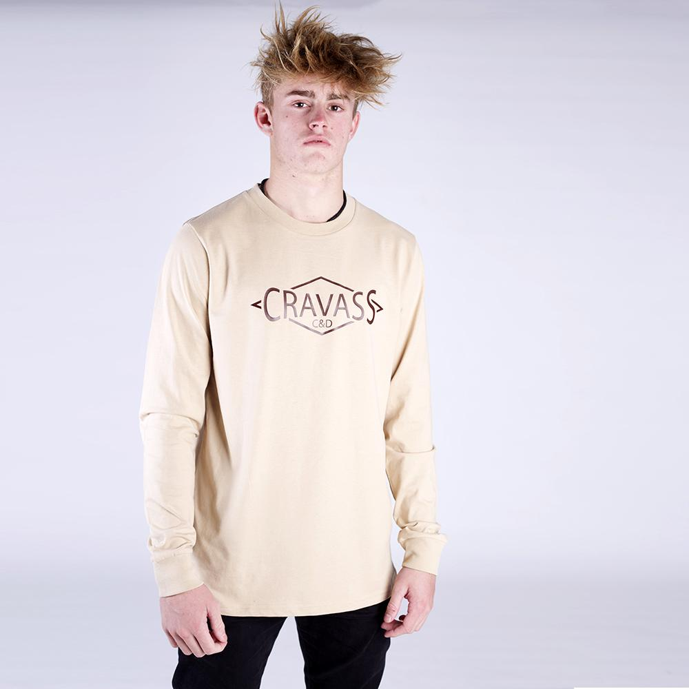 Front view of our Cravass tan long sleeve tshirt that has a brown and white maori design on the back