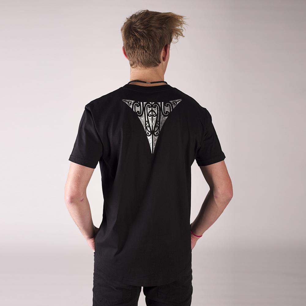 Male model wearing men's black tshirt with silver Triangle maori design on the back.