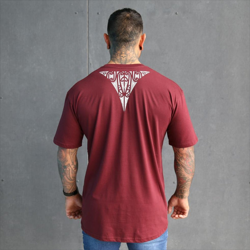 Mens maori tshirt with white design on a awesome burgundy tshirt. Back view.