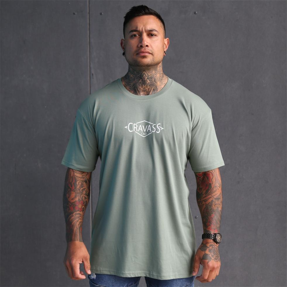 Mens sage coloured tshirt with white triangle maori design on the back. Maori clothing. Front view