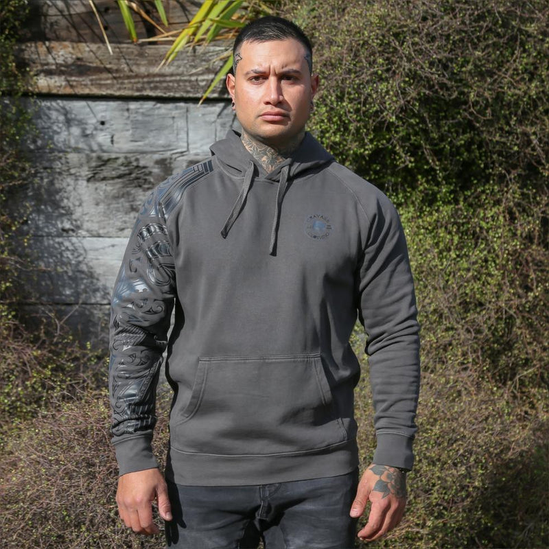 Black unisex hoodie with black and grey ta moko new zealand maori sleeve design. Front view